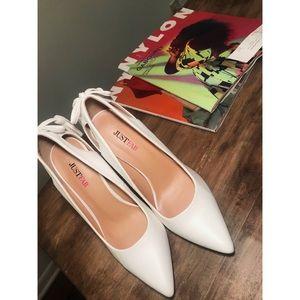 White tassel heels